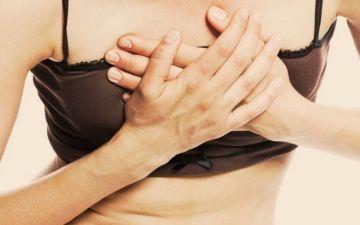 Почему болят грудные железы в середине цикла